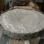 Plaster applied over cured silicone