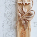 Working drawing next to carving showing Larch cones Hawthorn and varios foliage