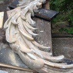 Paint stripped and new leaves carved in