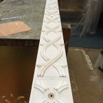 Plaster ornaments glued onto Plywood structure