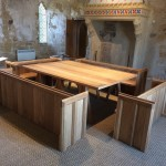 Oak pews and exchequer table in Battle Abbey