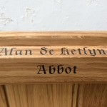 Hand painted lettering on pews